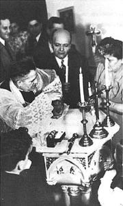 Baptism of Bruce Salem Bird, son of Naef (Frank) and Anne Shibley Bird -- Msgr. Malatios Mufleh officiating. March 7, 1948.