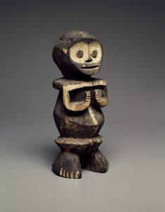 Standing figure with large eye sockets