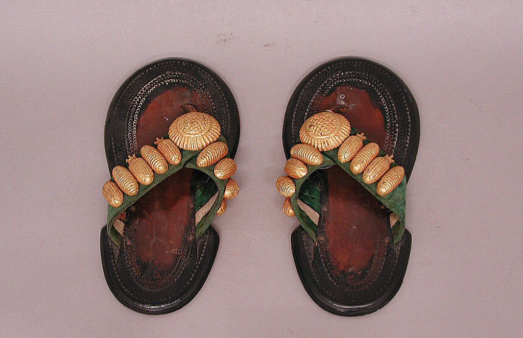 d250a2458 The gold-leafed wooden ornaments on these sandals represent a mixture of  beetles and their grubs