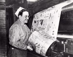 A pressman for the Cleveland Press changes a printing plate in 1953. Cleveland Public Library Photograph Collection.