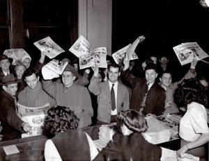 Happy Clevelanders crowd the lobby of the Cleveland Press on Feb. 6, 1946, to buy copies of the first edition printed since a pressmen's strike began Jan. 7, 1946. It was the first of four newspaper strikes in Cleveland. Cleveland Public Library Photograph Collection.