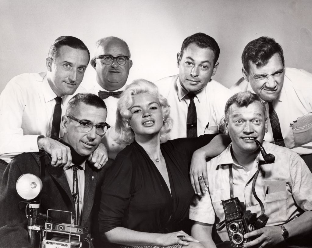 Actress Jayne Mansfield poses with Plain Dealer photographers. Back row, from left, Bill Ashbolt, Dudley Brumbach, Marvin Greene, Bill Wynne. Front row, from left, Karl J. Rauschkolb, Mansfield, Ray Matjasic. Special Collections, Cleveland State University Library.
