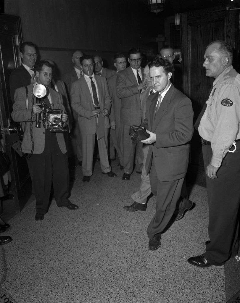Photographers and members of the press prepare for a day in the 1954 Sam Sheppard trial. Sheppard was on trial for killing his wife, Marilyn. Photography by William Ashbolt. Special Collections, Cleveland State University Library.