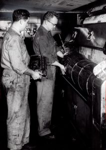 "The Plain Dealer plating press in 1961. From left are: Bob Carretta and Jim Sands. Plain Dealer photograph by William ""Bill"" Nehez. Cleveland Public Library Photograph Collection."