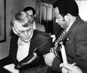 Cleveland City Council President George Forbes tosses Roldo Bartimole out of special council meeting on Sohio project in March 1981. Special Collections, Cleveland State University Library.