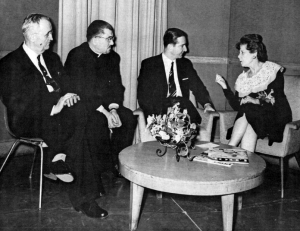 King Peter II of Yugoslavia chats with Dorothy Fuldhiem from TV Channel 5, in February, 1959, on a visit to the Serbian community. A reception was held at the Sheraton-Cleveland Hotel. Also present is the Chairman of the Reception Committee, Bogdan Dragisic, and Very Reverend Branko Kusonjic.