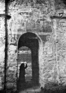 Fig. 13. Sopocani Monastery. Church of the Trinity. A Nun Ringing a Bell. Ruined Exonarthex from the East, 14th Century. (Photo: L.D. Popovich, 1971).